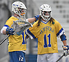 Tanner Griffin #11, Hofstra University defenseman, right, and goalie Jack Concannon #12 celebrate after a goal by the Pride in the fourth quarter of an NCAA Division I men's lacrosse game against UMass at Shuart Stadium in Hempstead on Saturday, April 22, 2017. Concannon made 13 saves in Hofstra's 15-8 win.