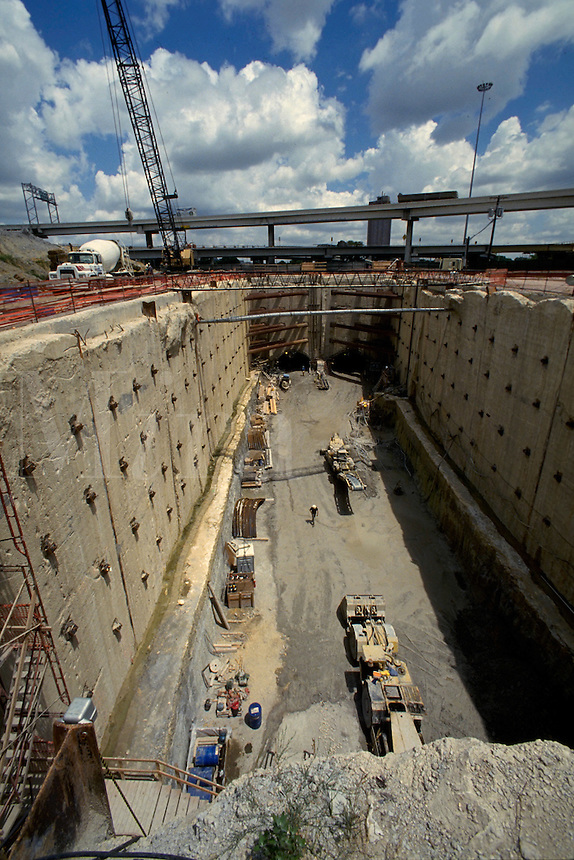View looking toward the tunnel portals at the base of what is called a U-wall construction site. The tunnels are where trains will eventually run.