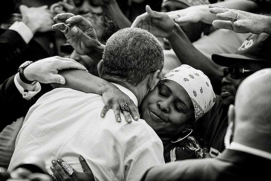 U.S. President Barack Obama is greeted by supporters during a campaign rally in Dayton, Ohio