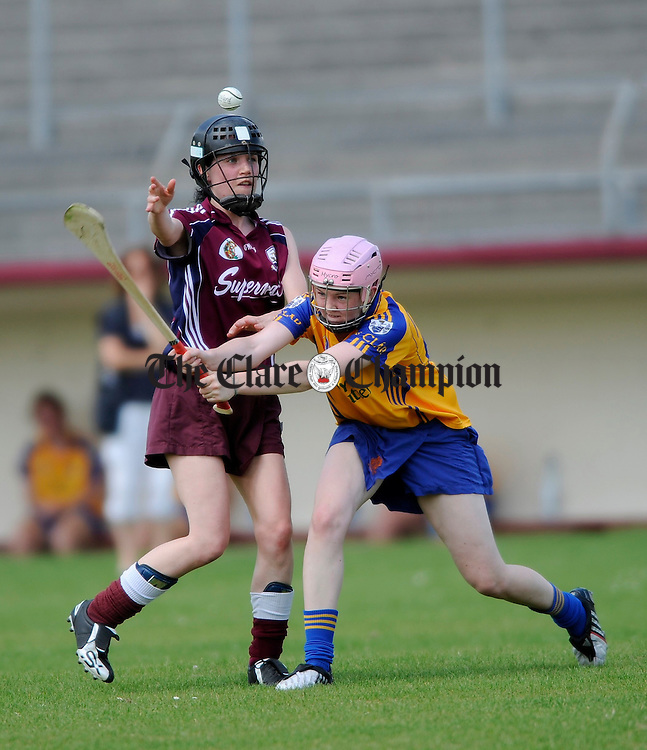 Clare's Lisa Loughnane tackles Galway's Colette Glennon during their Intermediate championship game at Athentry. Photograph by John Kelly.