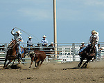 Mixed Team Ropers Megan Schrock and Clay Norell competing at the Southeast Weld County CPRA Rodeo on August 12, 2006.