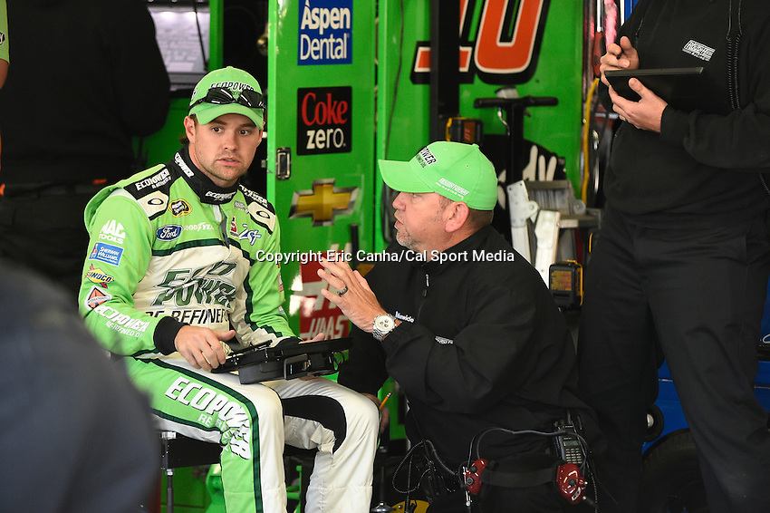 September 19, 2014 - Loudon, New Hampshire, U.S. -  Sprint Cup Series driver Ricky Stenhouse Jr. (17) reviews data on a tablet during a practice session of the NASCAR Sprint Cup Series Sylvania 300 held at the New Hampshire Motor Speedway in Loudon, New Hampshire.   Eric Canha/CSM