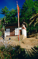 Farmer's home with prayer flags, Bhutan