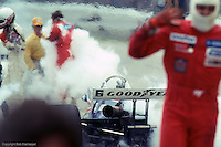 INDIANAPOLIS, IN - MAY 24: Rick Mears (left edge of frame) exits his Penske PC9B 005/Cosworth after it catches fire during a pit stop in the 1981 Indianapolis 500 on May 24, 1981, at the Indianapolis Motor Speedway in Indianapolis, Indiana.