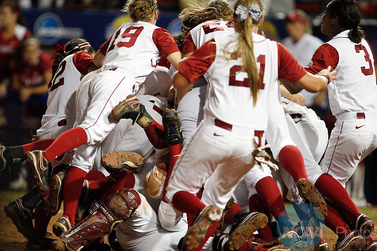 06 JUNE 2012:  The Crimson Tide dogpile onto Jackie Traina (33) of the University of Alabama after winning the Division I Women's Softball Championship held at ASA Hall of Fame Stadium in Oklahoma City, OK. Alabama defeated Oklahoma 5-4 to win the National Championship. Shane Bevel/NCAA Photos