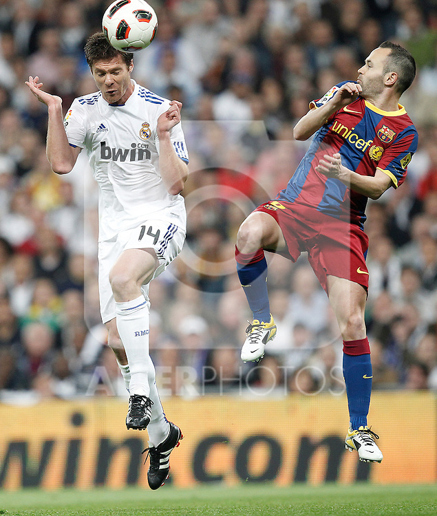 Real Madrid's Xabi Alonso and FC Barcelona's Andres Iniesta during la Liga match on April 16th 2011...Photo: Cesar Cebolla / ALFAQUI