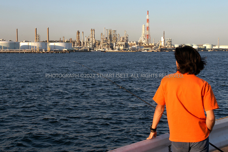 9/19/2002--Kawasaki, Japan..Oil refinery of the Nippon Oil Company along Tokyo Bay. ..All photographs ©2003 Stuart Isett.All rights reserved.This image may not be reproduced without expressed written permission from Stuart Isett.
