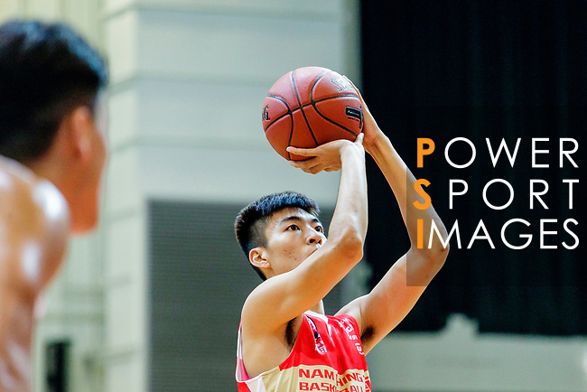 Yip Yiu Pong #35 of Nam Ching Basketball Team concentrates prior to a free throw during the Hong Kong Basketball League game between SCAA and Nam Ching at Southorn Stadium on May 4, 2018 in Hong Kong. Photo by Yu Chun Christopher Wong / Power Sport Images