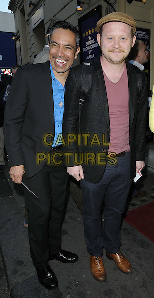 "David Bedella & Michael Jibson.The ""Merrily We Roll Along"" press night, Harold Pinter Theatre, Panton Street, London, England..May 1st, 2013.full length blue shirt black suit pink brown flat cap hat smiling .CAP/CAN.©Can Nguyen/Capital Pictures."