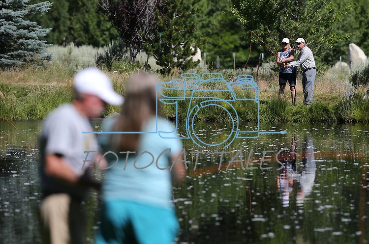 Breast cancer survivors participate in a Casting for Recovery fly-fishing retreat in Gardnerville, Nev., on Friday, June 30, 2017. The nationwide program, hosted locally with Carson Tahoe Cancer Center, pairs cancer survivors with fly-fishing guides.   <br /> Photo by Cathleen Allison/Nevada Photo Source