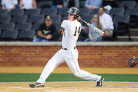 Conor Keniry (14) of the Wake Forest Demon Deacons follows through on his swing against the Maryland Terrapins at Wake Forest Baseball Park on April 4, 2014 in Winston-Salem, North Carolina.  The Demon Deacons defeated the Terrapins 6-4.  (Brian Westerholt/Four Seam Images)