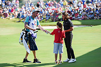 Tommy Fleetwood (ENG) and his caddie present a golve a signed ball to a young St. Jude patient near the green on 18 following round 4 of the WGC FedEx St. Jude Invitational, TPC Southwind, Memphis, Tennessee, USA. 7/28/2019.<br /> Picture Ken Murray / Golffile.ie<br /> <br /> All photo usage must carry mandatory copyright credit (© Golffile | Ken Murray)