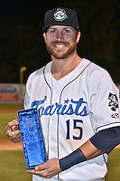 Asheville Tourists first baseman Brian Mundell (15) holds his league MVP award after a game against the Hagerstown Suns at McCormick Field on September 4, 2016 in Asheville, North Carolina. The Suns defeated the Tourists 10-5. (Tony Farlow/Four Seam Images)