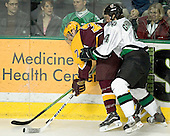 Gino Guyer, Taylor Chorney - The University of Minnesota Golden Gophers defeated the University of North Dakota Fighting Sioux 4-3 on Saturday, December 10, 2005 completing a weekend sweep of the Fighting Sioux at the Ralph Engelstad Arena in Grand Forks, North Dakota.