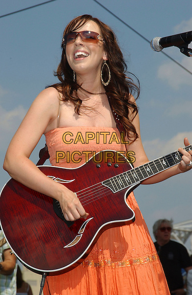 REBECCA LYNN HOWARD.2006 CMA Music Festival held at the Greased Lightening Daytime Stage at Riverfront Park, Nashville, Tennessee, USA,10 June 2006..half length guitar live concert music country orange dress.Ref: ADM/LF.www.capitalpictures.com.sales@capitalpictures.com.©Laura Farr/AdMedia/Capital Pictures.