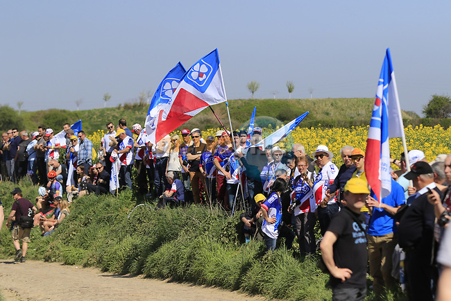 Colourful fans on pave sector 29 Troisvilles a Inchy during the 115th edition of the Paris-Roubaix 2017 race running 257km Compiegne to Roubaix, France. 9th April 2017.<br /> Picture: Eoin Clarke | Cyclefile<br /> <br /> <br /> All photos usage must carry mandatory copyright credit (&copy; Cyclefile | Eoin Clarke)
