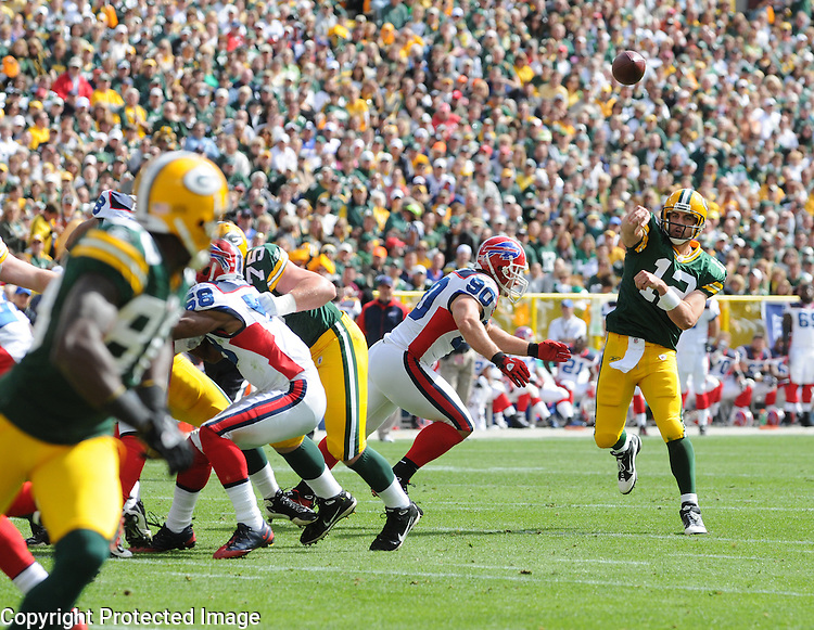 Green Bay Packers quarterback Aaron Rodgers, right, fires a touchdown pass to Donald Driver, left, in the third quarter against the Buffalo Bills during the home opener at Lambeau Field in Green Bay, Wis., on Sunday, Sept. 19, 2010.