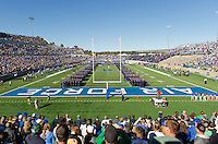 United States Air Force Academy cadets stand on the field for the national anthem.