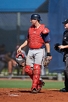 GCL Twins catcher Austin Hale (70) stands in front of home plate umpire Joe Belangia during a game against the GCL Rays on August 9, 2018 at Charlotte Sports Park in Port Charlotte, Florida.  GCL Twins defeated GCL Rays 5-2.  (Mike Janes/Four Seam Images)