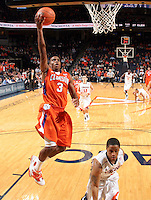 Feb. 2, 2011; Charlottesville, VA, USA; Clemson Tigers guard Zavier Anderson (3) shoots over Virginia Cavaliers guard Jontel Evans (1) during the game at the John Paul Jones Arena. Virginia won 49-47. Mandatory Credit: Andrew Shurtleff