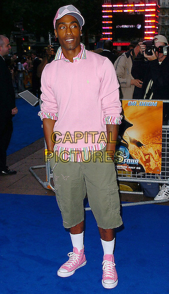 "SIMON WEBBE (BLUE).At the UK Film Premiere of ""Fantastic Four"",.Vue Cinema, Leicester Square, .London, July 18th 2005..full length webb pink jumper striped shirt collar cropped green shorts white socks converse trainers baseball boots fashion disaster funny hands in pockets.Ref: CAN.www.capitalpictures.com.sales@capitalpictures.com.©Can Nguyen/Capital Pictures."