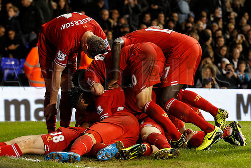 15.12.2013. White Hart Lane,  London, England. Jon FLANAGAN of Liverpool is mobbed by team mates after scoring his first goal for the club during the Barclays Premier League match between Tottenham Hotspur and Liverpool at White Hart Lane.