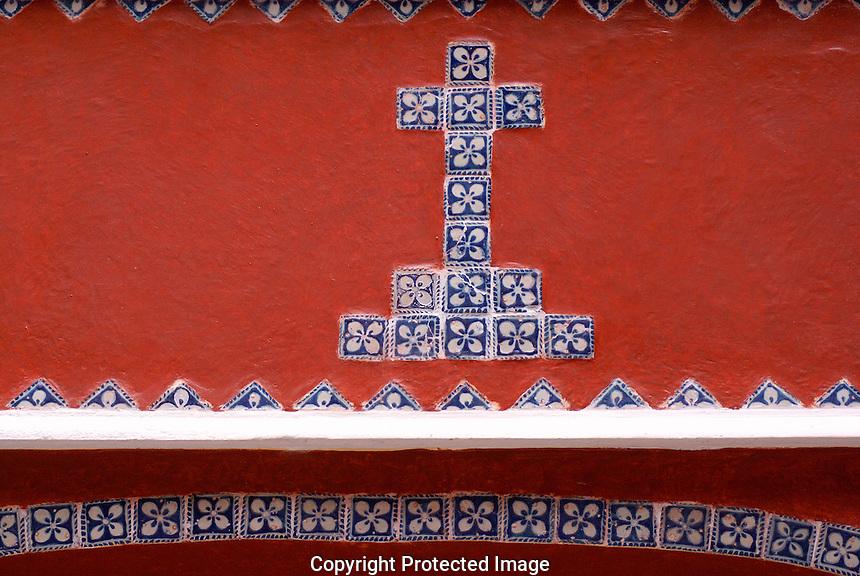 Blue and white Talavera tile crucifix, Museo Casa del Afenique, Puebla, Mexico. The historical center of Puebla is a UNESCO World Heritage Site.                      .