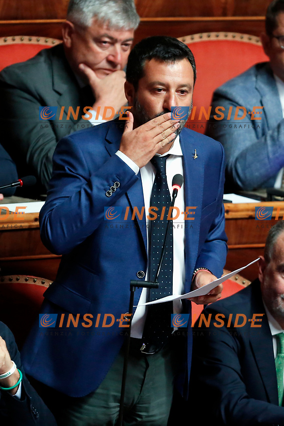 Matteo Salvini sends a kiss to the senators of Democratic Party that are protesting against his speech<br /> Rome August 13th 2019. Senate. Vote to allow  ore deny the Motion of no confidence to the Italian Government proposed by the Lega Nord party. <br /> Foto Samantha Zucchi Insidefoto