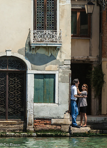 Friends  conversing along the Grand Canal, Venice, Italy