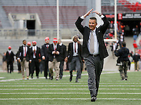 Ohio State Buckeyes head coach Urban Meyer completes the O-H-I-O as players walk into the stadium prior to the NCAA football game against the Michigan State Spartans at Ohio Stadium in Columbus on Nov. 21, 2015. (Adam Cairns / The Columbus Dispatch)