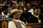 Church  of God of Prophecy west London. A  member of the congregation listens to the Sunday sermon. from A STORM IS PASSING OVER a Look at Black Churches in Britain. Published by Thames and Hudson isbn 0 500 27826 1