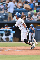 Asheville Tourists center fielder Yonathan Daza (2) swings at a pitch during a game against the Columbia Fireflies at McCormick Field on June 17, 2016 in Asheville, North Carolina. The Tourists defeated the Fireflies 6-2. (Tony Farlow/Four Seam Images)