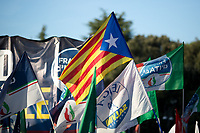 """Catalan Flag.<br /> <br /> Rome, 19/10/2019. Today, tens thousands of people (200,000 for the organisers, 50,000 for the police) gathered in Piazza San Giovanni to attend the national demonstration """"Orgoglio Italiano"""" (Italian Pride) of the far-right party Lega (League) of Matteo Salvini. The demonstration was supported by Silvio Berlusconi's party Forza Italia and Giorgia Meloni's party Fratelli d'Italia (Brothers of Italy, right-wing).  <br /> The aim of the rally was to protest against the Italian coalition Government (AKA Governo Conte II, Conte's Second Government, Governo Giallo-Rosso, 1.) lead by Professor Giuseppe Conte. The 66th Government of Italy is a coalition between Five Star Movement (M5S, 2.), Democratic Party (PD – Center Left, 3.), and Liberi e Uguali (LeU – Left, 4.), these last two parties replaced Lega / League as new members of a coalition based on Parliamentarian majority as stated in the Italian Constitution. The Governo Conte I (Conte's First Government, 5.) was 14-month-old when, between 8 and 9 of August 2019, collapsed after the Interior Minister Matteo Salvini withdrew his euroskeptic, anti-migrant, right-wing Lega / League (6.) from the populist coalition in a pindaric attempt (miserably failed) to trigger a snap election.<br /> <br /> Footnotes & Links:<br /> 1. http://bit.do/feK6N<br /> 2. http://bit.do/e7JLx<br /> 3. http://bit.do/e7JKy<br /> 4. http://bit.do/e7JMP<br /> 5. http://bit.do/e7JH7<br /> 6. http://bit.do/eE7Ey<br /> https://www.leganord.org<br /> http://bit.do/feK9X (Source, TheGuardian.com)<br /> Reportage: """"La Fabbrica Della Paura"""" (The Factory of Fear): http://bit.do/feLcy (Source Report, Rai.it - ITA)<br /> (Update) Reportage: """"La Fabbrica Social Della Paura"""" (The Social Network Factory of Fear): http://bit.do/fe8Pn (Source Report, Rai.it - ITA)"""