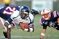 30 October 2010:  FIU running back Kedrick Rhodes (9) dives for a first down in the third quarter as the Florida Atlantic University Owls defeated the FIU Golden Panthers, 21-9, at Lockhart Stadium in Fort Lauderdale, Florida.