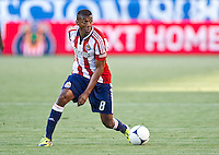 CARSON, CA - April 1, 2012: Oswaldo Minda (8) of Chivas during the Chivas USA vs Sporting KC match at the Home Depot Center in Carson, California. Final score Sporting KC 1, Chivas USA 0.