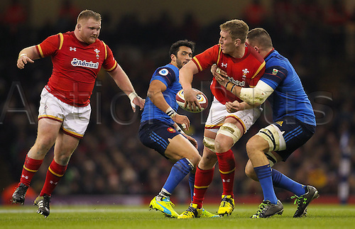 26.02.2016. Principality Stadium, Cardiff, Wales. RBS Six Nations Championships. Wales versus France. Wales Bradley Davies looks to offload the ball to Wales Samson Lee as he gets tackled