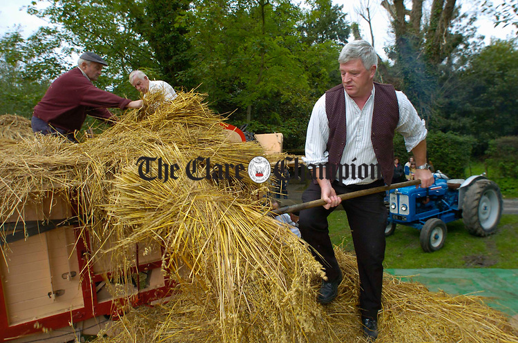 Newmarket's Paul Tuohy forking to the trasher  during the Bunratty Harvest fair. Photograph by John Kelly.