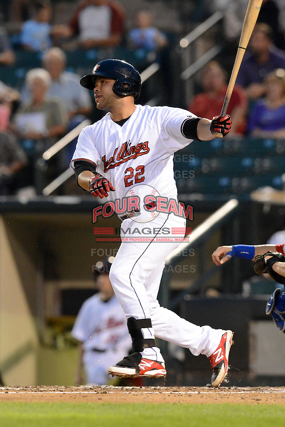 Rochester Red Wings catcher Josmil Pinto (22) during a game against the Buffalo Bisons on August 30, 2013 at Frontier Field in Rochester, New York.  Buffalo defeated Rochester 6-3.  (Mike Janes/Four Seam Images)