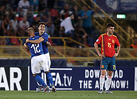 Football: Uefa European under 21 Championship 2019, Italy - Spain Renato Dall'Ara stadium Bologna Italy on June16, 2019.<br /> Italy's Federico Chiesa (c) celebrates after scoring with his teammate Federico Dimarco (l) while Spain's Martin Aguirregabiria (r) looks on  during the Uefa European under 21 Championship 2019 football match between Italy and Spain at Renato Dall'Ara stadium in Bologna, Italy on June16, 2019.<br /> UPDATE IMAGES PRESS/Isabella Bonotto