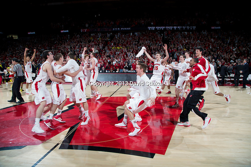 Wisconsin Badgers celebrate during a Big Ten Conference NCAA college basketball game against the Michigan Wolverines Saturday, February 9, 2013, in Madison, Wis. The Badgers won 65-62 (OT). (Photo by David Stluka)