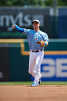 Buffalo Bisons Andy Burns (9) warmup throw to first base during an International League game against the Lehigh Valley IronPigs on June 9, 2019 at Sahlen Field in Buffalo, New York.  Lehigh Valley defeated Buffalo 7-6 in 11 innings.  (Mike Janes/Four Seam Images)