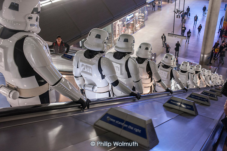 Actors dressed as Star Wars Stormtroopers in a PR stunt at Canary Wharf tube station to promote the release of Rogue One: A Star Wars Story, in which it features.