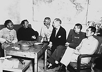 Conference at Yenan Communist Headquarters before Mao Tze Tung, chairman, left for Chungking meeting.  Central figures are U.S. Ambassador Patrick J. Hurley, Col. I.V. Yeaton, U.S. Army Observer, and Mao Tze Tung.  August 27, 1945.  T5c. Frayne.  (Army)<br /> NARA FILE #:  111-SC-360599<br /> WAR & CONFLICT BOOK #:  1152