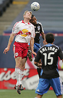 New York Red Bulls' John Wolyniec, left, battles San Jose Earthquakes' James Riley, right, for a header in the first half of an MLS soccer match at Giants Stadium in East Rutherford, N.J. on Sunday, April 27, 2008. The Red Bulls defeated the Earthquakes 2-0.