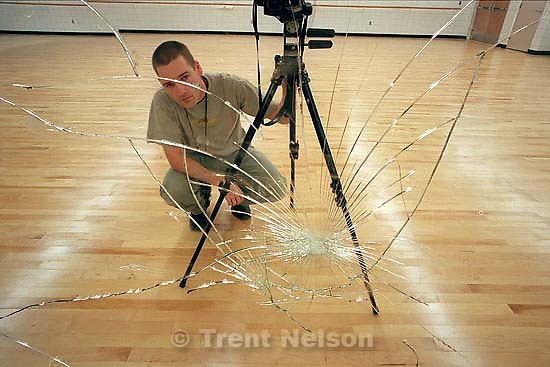 Trent Nelson in shattered mirror at Century High School for Richardson.<br />