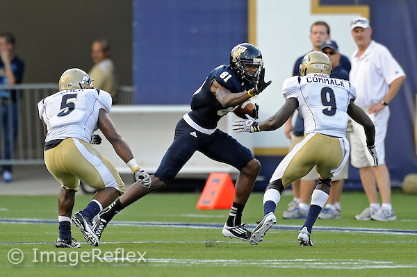 8 September 2012:  FIU wide receiver Jairus Williams (81) attempts to evade Akron cornerback Avis Commack (9) after a reception in the first quarter as the FIU Golden Panthers defeated the Akron Zips, 41-38 (overtime), at FIU Stadium in Miami, Florida.