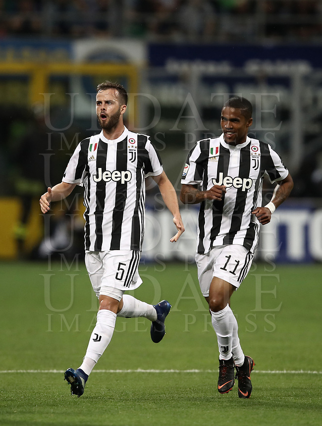 Calcio, Serie A: Inter - Juventus, Milano, stadio Giuseppe Meazza (San Siro), 28 aprile 2018.<br /> Juventus Douglas Costa (r) celebrates after scoring with his teammate Miralem Pjanic (l) during the Italian Serie A football match between Inter Milan and Juventus at Giuseppe Meazza (San Siro) stadium, April 28, 2018.<br /> UPDATE IMAGES PRESS/Isabella Bonotto