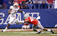 Ohio State Buckeyes linebacker Darron Lee (43) gets after Wisconsin Badgers running back Melvin Gordon (25) in the third quarter of the Big Ten Championship game between the Ohio State Buckeyes and the Wisconsin Badgers at Lucas Oil Stadium in Indianapolis, Saturday night, December 6, 2014. As of half time the Ohio State Buckeyes led the Wisconsin Badgers 38 - 0. (The Columbus Dispatch / Kyle Robertson)