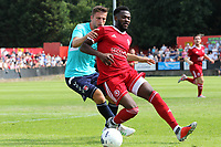 Anthony Cook of Welling shields the ball from Charlton's Ben Purrington during Welling United vs Charlton Athletic, Friendly Match Football at the Park View Road Ground on 13th July 2019