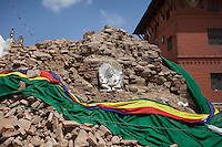 A artefact lays on the ground of the Shoyembho temple, just outside Kathmandu, Nepal